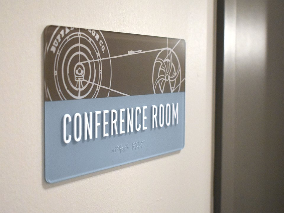 Wayfinding signage: example of a room sign. The Forge on Broadway by OtherWisz Creative.